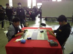 Local player Genki Yoshimura takes on Watanabe on day 2